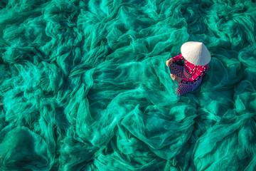 Fototapeta Vietnam Fishermen are repairing fishing nets Fishermen are cleaning Thai fishing nets. obraz