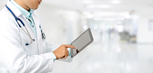 Male doctor using tablet computer at hospital. Medical research staff and doctor service.