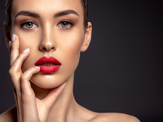 Beautiful woman with bright make-up and red lips. Wall mural
