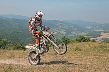 bikers riding enduro motorcycles KTM 350 EXC
