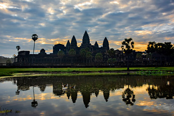 Wall Mural - Sunrise at Angkor Wat temple,  the largest religious monument in the world.