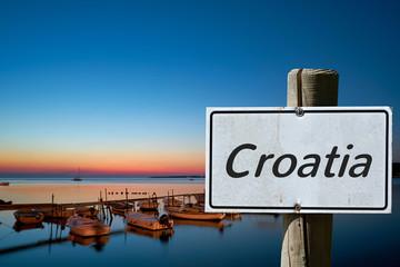 Sign with the inscription Croatia on the coast of Croatia in summer
