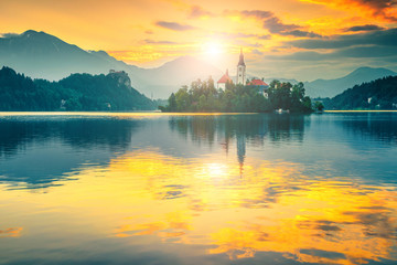 Wall Mural - Pilgrimage church with island and lake Bled at sunrise, Slovenia