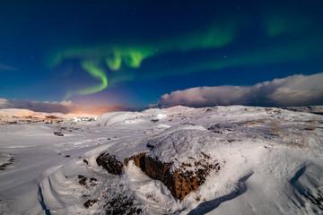 Fotorolgordijn Grijs Northern Lights on the shore of the Arctic Ocean.