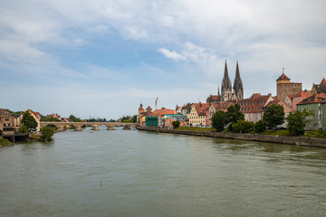 Panorama view of the stone bridge and historical old town of Regensburg or Ratisbon on river side of Danube