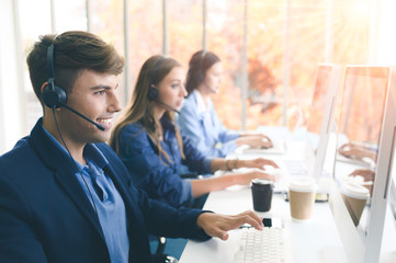 Call Center Service. Photo of customer support or sales agent.  Help line answering and telemarketing. Male caller or receptionist phone operator.Copy space for some text, advertising or slogan.