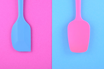 bright kitchen utensils on pink and blue background, creative idea