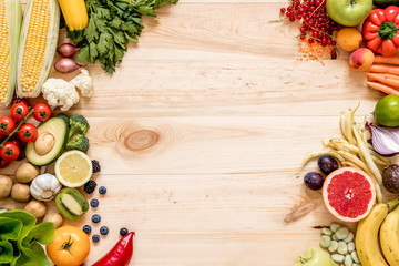 Modern composition of fresh healthy vegetables and fruits on the wooden table in the kitchen. Healthy detox and balance diet. Lifestyle. Vegetarian vegan background. Zero waste. Top view. Copy space.
