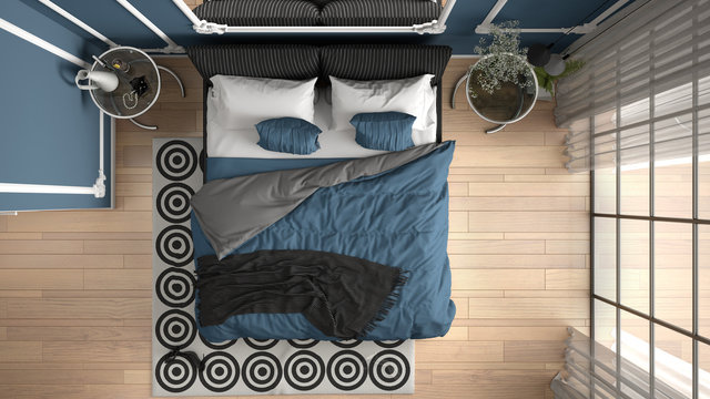 Modern blue colored bedroom in classic room with wall moldings, parquet floor, bed with duvet and pillows, bedside tables, mirror and decors. Interior design concept, top view