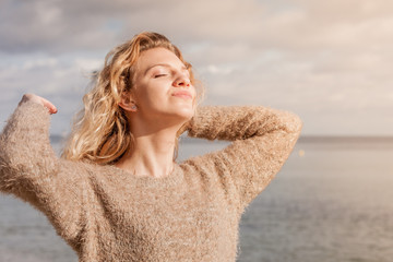 Happy woman outdoor wearing jumper