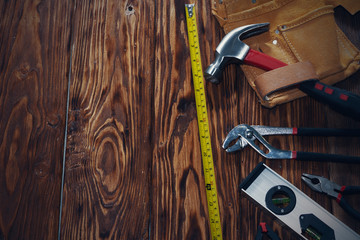 Close up tools on a wooden background.