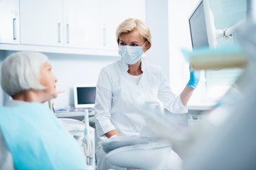 Female dentist is communicating with the patient