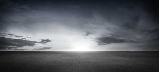 Foto op Aluminium Grijs Dramatic Black White Floor Background with Panoramic Cloudy Sky