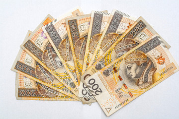 Hand fan made of nine two hundred zloty polish banknotes on white background