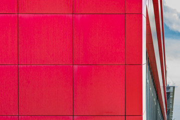 Modern red office building exterior. Square pattern background.