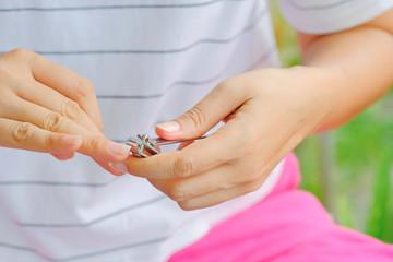 A woman cutting a nail