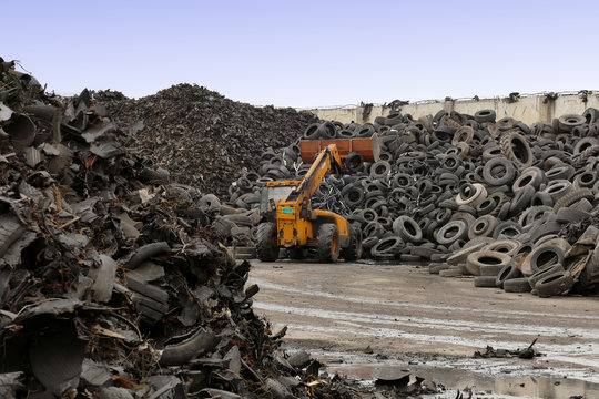 Tire Recycling Plant / Pile of tires prepared for recycling at the factory