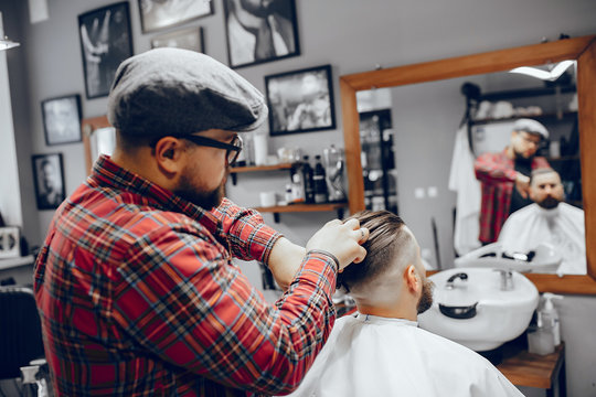 Man with a beard. Hairdresser with a client. Man in a red shirt