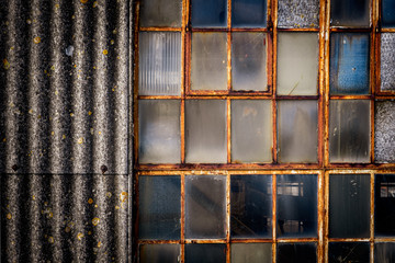 Textures on old industrial window and corogated asbestos