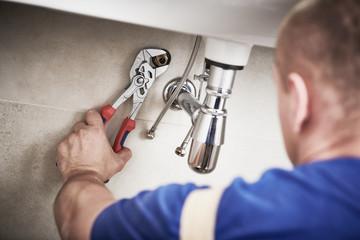 plumber service. sink trap siphon installation