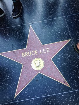 Hollywood, California - July 26 2017: Bruce Lee Hollywood walk of fame star on July 26, 2017 in Hollywood, CA. Lee Jun-fan, known professionally as Bruce Lee, was a Hong Kong and American actor, film