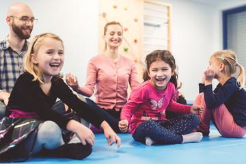 Kindergarten Teachers doing Children's Yoga with the kids