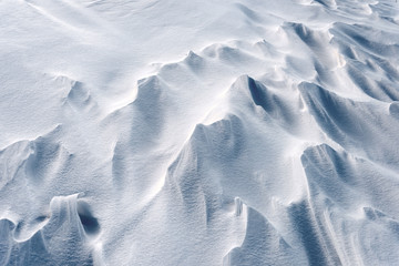 Winter snow blizzard patterns from a frozen season tundra with nobody in the image