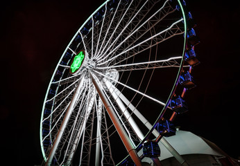 Ferris Wheel Amusement Park Ride with Lights at Night