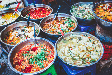 delicious fresh street food in Thailand - top view - Thai Curry, Tamarind, Tom Yam, Shrimp, Pork, Pad Thai