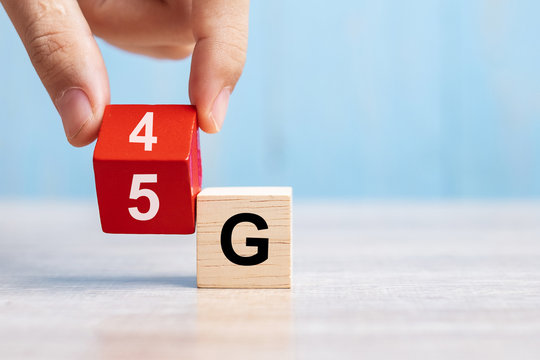 Businessman hand change wooden block from 4G to 5G. Technology, network, communication concept