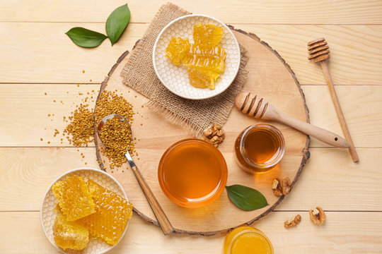 Composition with sweet honey on wooden table