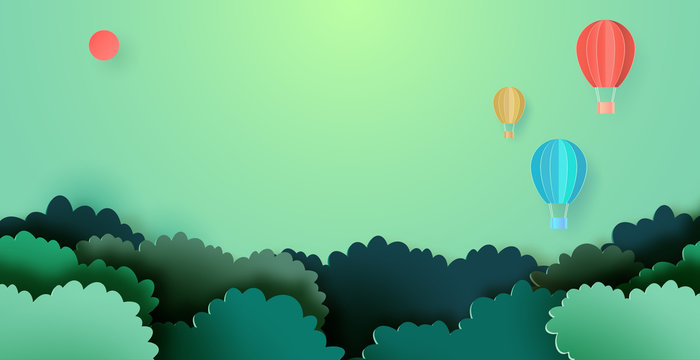 Hot air balloons floating on forest nature landscape background paper art style.Vector illustration.