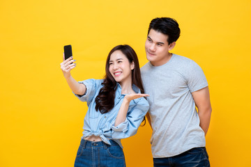 Charming young asian couple taking a selfie togethe