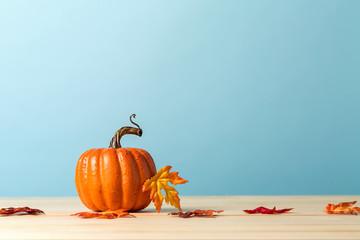 A autumn pumpkin on a blue background