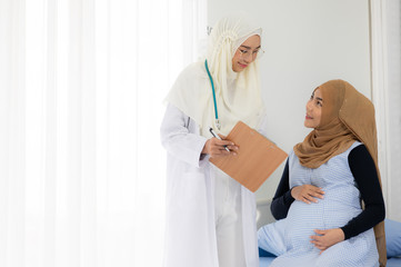 Pregnant muslim women pregnancy check up with Muslim doctors. To monitor the strength of the mother and child in the womb And rehearsing the give birth to child.