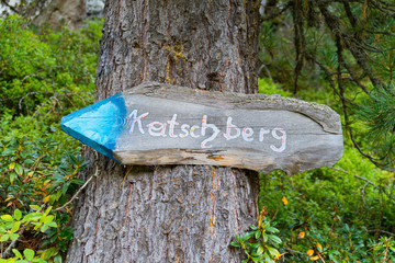 Signpost to Katschberg, small town and mountain in the Austrian Alps
