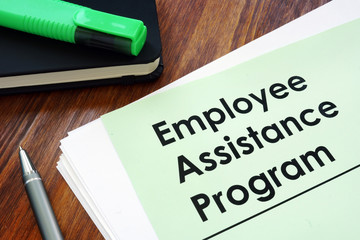 Employee assistance program EAP - benefit program on the desk.