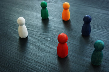 Diversity and inclusion for business concept. Colored figurines on the desk.