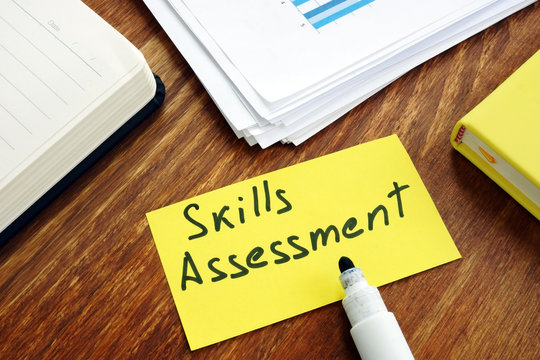 Skills Assessment concept. Yellow piece of paper on a desk.