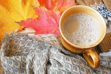 hot cappuccino and autumn leaves on a wooden table, cappuccino cooking, autumn mood