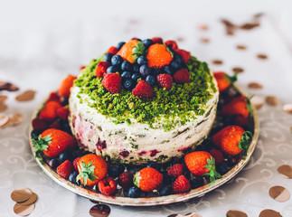 Birthday cake with fresh fruits. Healthy homemade dessert