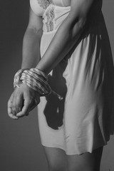 Detail of an attractive hands tied woman