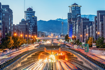 06/05/2019 Tehran,Iran,Famous night view of Tehran,Flow of traffic round Tohid Tunnel with Milad Tower and Alborz Mountains in Background, Tohid Tunnel one of longest urban tunnel in Middle East