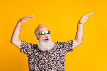 Photo of dancing cheerful rejoicing cool old man feeling young dancing in front of yellow vivid background he is isolated over