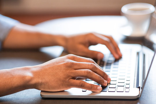 Male hands typing programming code or text on laptop