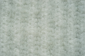 Background with knitted white texture.