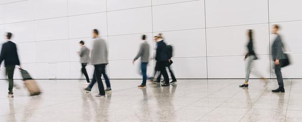 Fototapete - trade fair visitors walking in a clean futuristic corridor