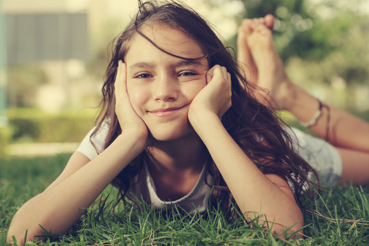 Outdoor close up portrait of teen 12 years old girl