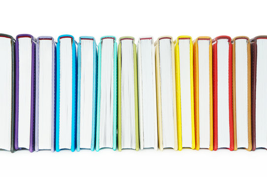 Books with Colorful Book Covers Lined up in a Row, Isolated on White. Education Concept. Bright Background with Copy Space.