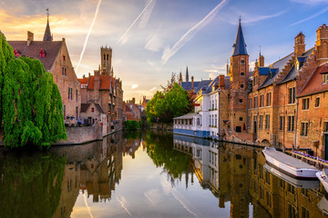 Wall Mural - Classic view of the historic city center of Bruges (Brugge), West Flanders province, Belgium. Sunset cityscape of Bruges. Canals of Brugge
